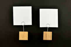 Two paper notes with holders on black for presentation Royalty Free Stock Image