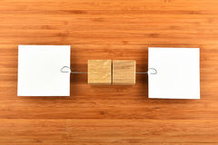 Two paper notes with holders in different directions on wood Royalty Free Stock Photography