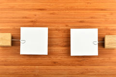 Two paper notes with holders in different directions on wood Stock Photo
