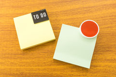 Two Paper Notes To Do List with Red Circle. Two Paper Note To Do List with a Red Circle Placed on Wooden Table Stock Photo