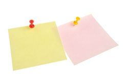 Two paper sheets attached with office buttons. Two paper sheets attached with yellow and red office buttons isolated on white background Stock Images