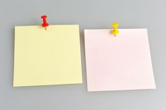 Two paper sheets with office buttons on gray Royalty Free Stock Photography