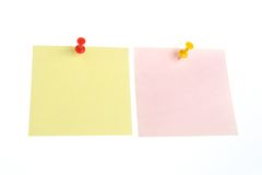 Two paper sheets with office buttons isolated. Two paper sheets attached with yellow and red office buttons isolated on white background Stock Image