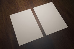 Two paper sheets on wood. Two blank white paper sheets on wooden desktop. Mock up, 3D Rendering royalty free illustration
