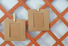 Two papers hanging on the wood. En board Stock Photo