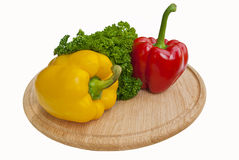 Two paprika on cutting board Royalty Free Stock Images