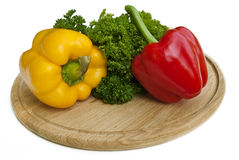 Two paprika on cutting board Stock Photography