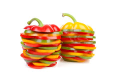 Two Paprika made out of colorful slices Royalty Free Stock Images