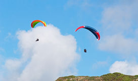 Two para gliders under clouds Royalty Free Stock Images