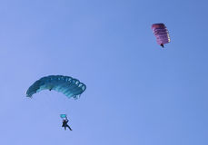 Two parachutes. On a bright sunny day Royalty Free Stock Photo
