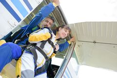Two parachutists jumping out airplane in free style royalty free stock images