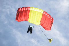 Two Parachutists in Tandem Jump. Mid-life Crisis? Tandem Sky Divers coming down from an 18,000 foot jump Royalty Free Stock Photo