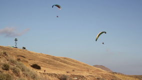 Two paraglider above the bay. With mountains stock footage