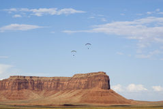 Two paragliders. Two powered paraglider pilots in flight over Monument Valley Royalty Free Stock Photos