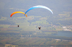 Two paragliders in the air. In french Alps near Grenoble, France Stock Image