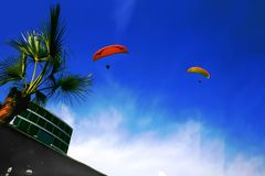 Two Paragliders on a Blue Sky in Lima - Peru royalty free stock images