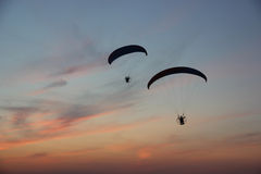 Two paragliders in the dramatic sky Royalty Free Stock Photography