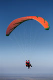 Two paragliders in flight above the land Royalty Free Stock Photos