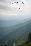 Two paragliders. From North-West Italy mountains, near Limonetto, Western Alps Stock Images