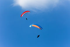 Two paragliders in the sky Royalty Free Stock Photos