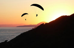 Two paragliders at sunset. Coastal landscape Royalty Free Stock Photo