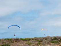 Two Parakiters Sailing Over Monterey Bay Stock Photography