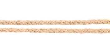 Two parallel ropes. On white background with clipping path royalty free stock images