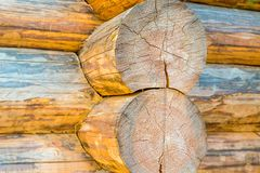 Two parallel vertical logs large base of a wooden house traditional construction close-up of a weathered wooden background stock photography