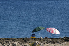Two parasol on the shore Stock Photography