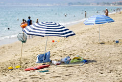 Two parasols on the busy beach Stock Photo