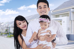 Two parents and child at new residential Royalty Free Stock Image