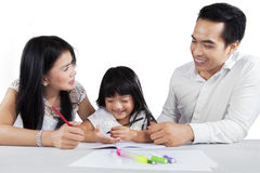 Two parents teach their child to study Royalty Free Stock Photo