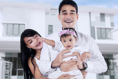 Two parents with their baby in new home Stock Photography