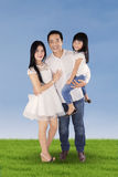 Two parents with their daughter on meadow Royalty Free Stock Image