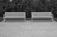Two park benches Stock Images