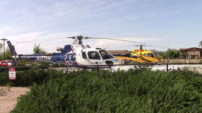 Two parked Medical Emergency Helicopters. Mesa, Arizona, USA - April 21 2015:  Two medi-vac emergency helicopters on standby in the hospital landing pad. Taken stock footage