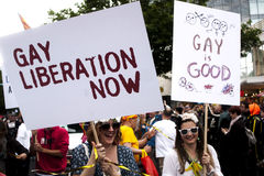Two participant of gay pride parade with placards Royalty Free Stock Photo