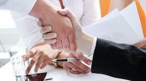Two partners shaking hands Stock Photo