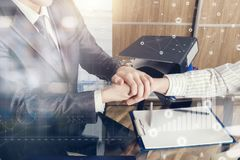 Two partners are shaking hands at the office symbolizing the successful contract stock image