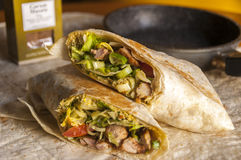 Two parts of asiian wrap with chicken meat and garam masala Royalty Free Stock Photography
