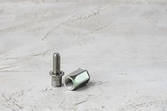 Two parts of metal pop Rivet fastener on grey cement background. Horizontal with copy space for text and design. Ingeneering. Two parts of metal pop Rivet royalty free stock photos