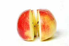 Two parts of one apple. Cut into two equal parts on a white background, still life, red juicy fruits of apple, colors of nature, food, juice, fruit Stock Images
