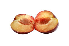 Two parts of a plum stock image