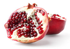 Two parts of pomegranate. Isolated on white background royalty free stock photo