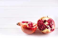 Two parts of a pomegranate Stock Images