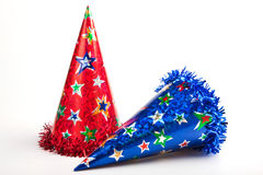 Two party hats. Shiny party hats on white background royalty free stock photos