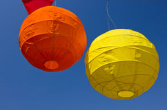 Two party paper lanterns. Colorful party or fair paper lanterns, balloons hanging in the sky Stock Images
