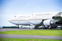 Two passenger airliners parked side by side on airport apron wir Royalty Free Stock Photo