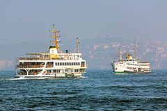 Two passenger ferryboats in the Bosphorus, Istanbul, Turkey Stock Images