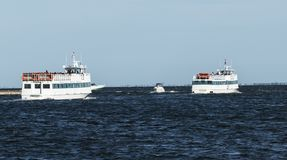 Two passenger Fire Island Ferry Boats full with passengers heading into the bay stock image